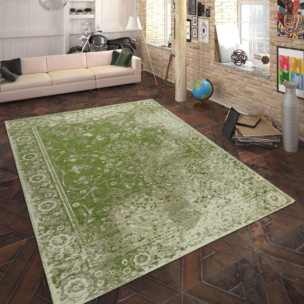 Vardagsrum med grön matta.  Källa: Rug24.co.uk