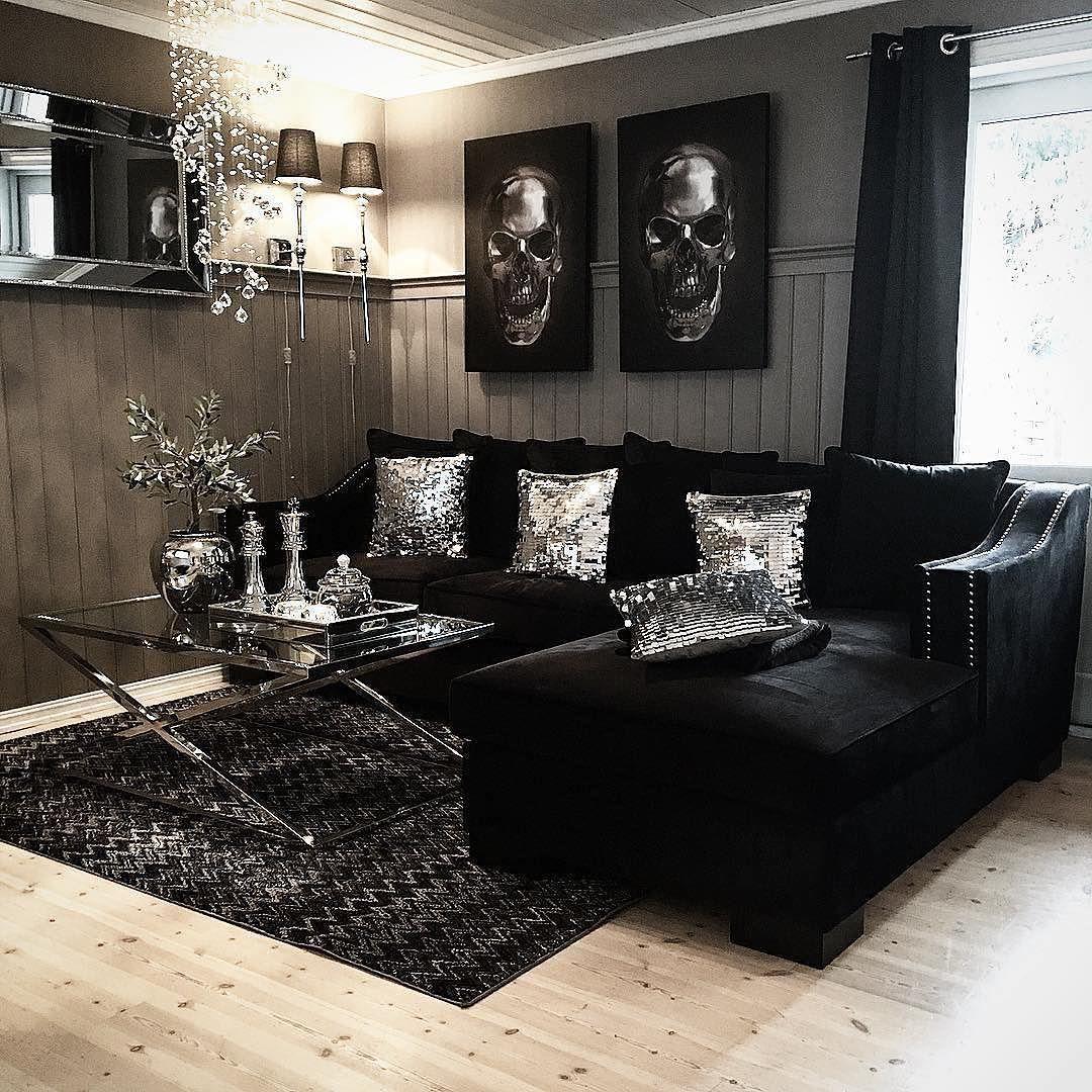 Elegant svart soffa med ottomaner