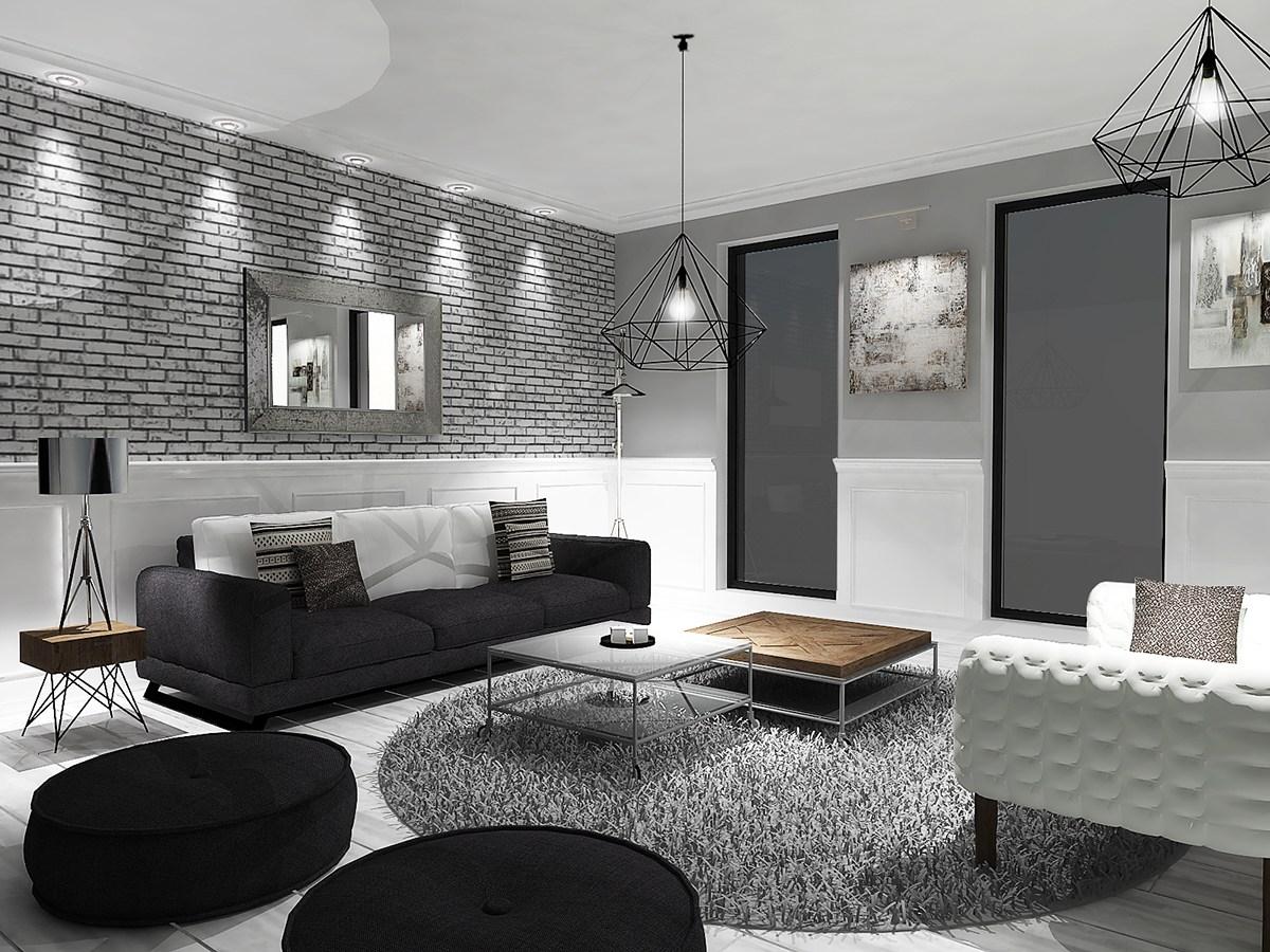 Enkel svart soffa med rundade svarta ottomaner