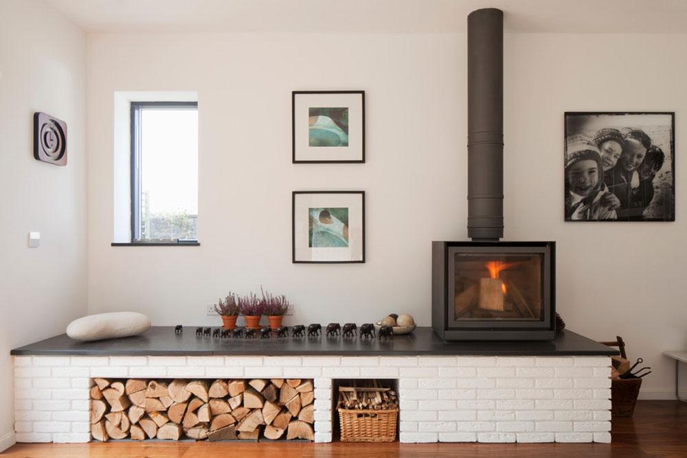 Hidden-House-Ashburton-Devon-by-van-Ellen-Sheryn-Architects Ett vardagsrum med öppen spis och dekorinstruktioner