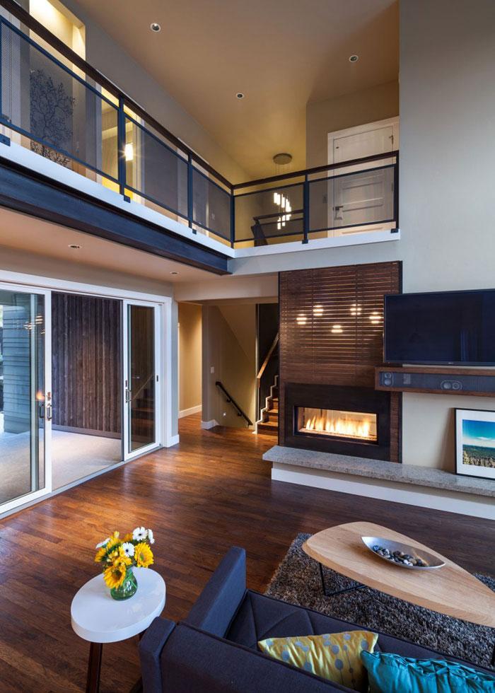 82285430710 Hus med natursten och trä exteriör och en avancerad interiör