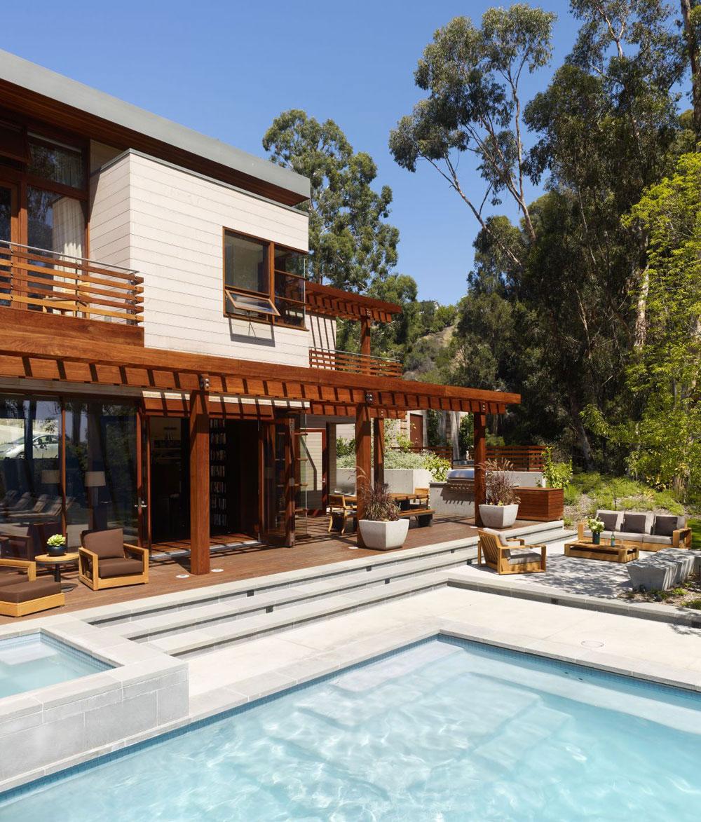 Lyxigt hem omgivet av träd som kompletterar dess eleganta möbler 4 Lyxigt hem omgivet av träd som kompletterar dess eleganta möbler